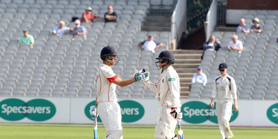 lancashires rob jones and liam livingstone reach their 100 partnership at emirates old trafford against middlesex.jpg
