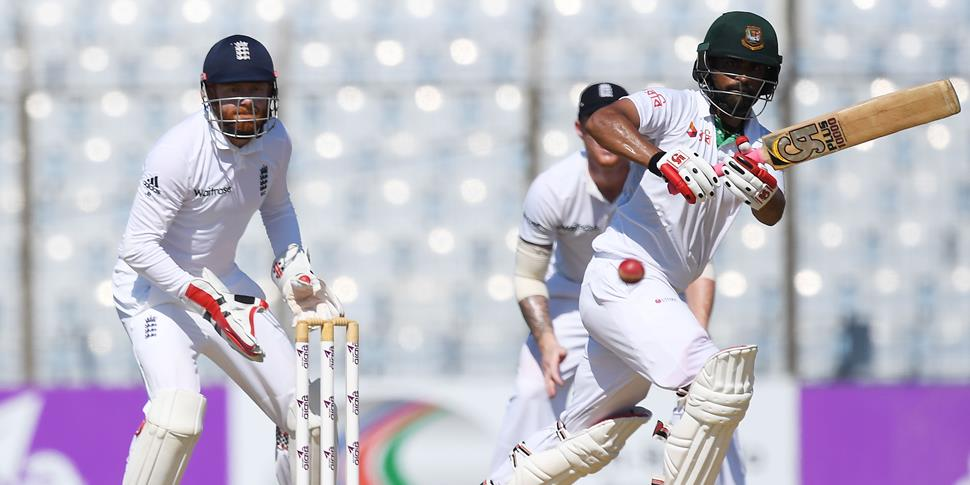 Bangladesh's Tamim Iqbal plays a shot as England Cricketer Jonny Bairstow looks on during the Second Test.jpg