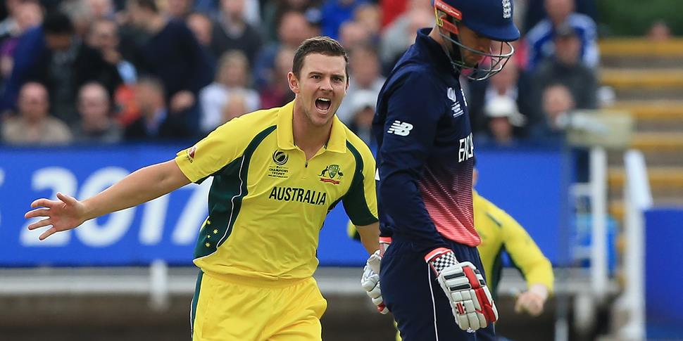 Australia's Josh Hazlewood (L) celebrates taking the wicket of England's Alex Hales (R) during the ICC Champions Trophy match between England and Australia.jpg