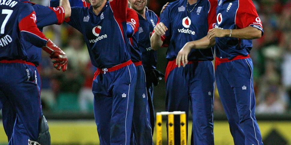 The England team celebrate after captain Andrew Flintoff (2nd R) took the wicket of Australia's Michael Hussey for no runs during the second tri-series cricket one-day final.jpg