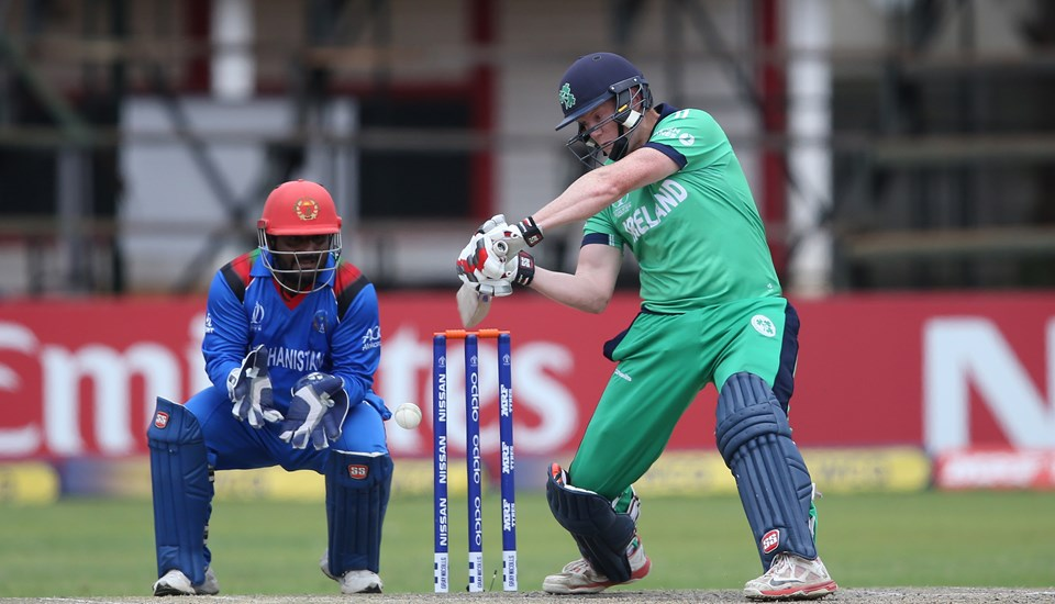 Muhammad Shahzad of Afghanistan looks on as Kevin O'Brien of Ireland scores runs during The ICC Cricket World Cup Qualifier between Ireland and Afghanistan.jpg