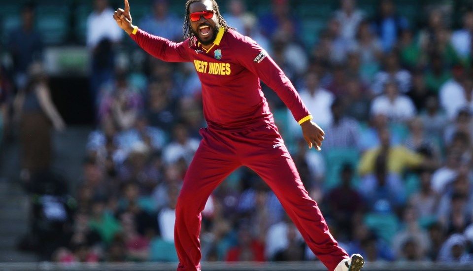 Chris Gayle of the West Indies takes a wicket against South Africa in the Cricket World Cup in Australia.jpg