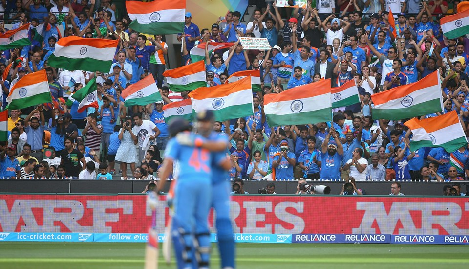 Fans celebrate during India's game against Bangladesh at the MCG in Australia.jpg