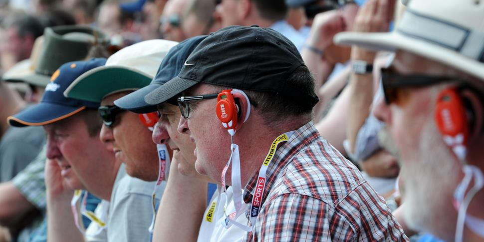 A fan watches England at Lancashire COunty Cricket Club.jpg