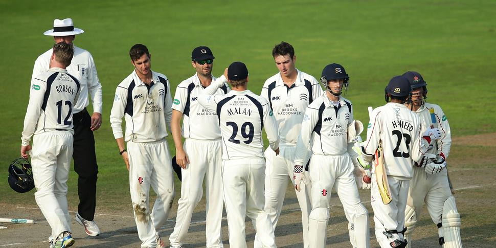 Lancashire batsman Haseeb Hameed and Rob Jones shake hands with the Middlesex CCC players at the end of the Specsavers County Championship fixture at Old Trafford.jpg