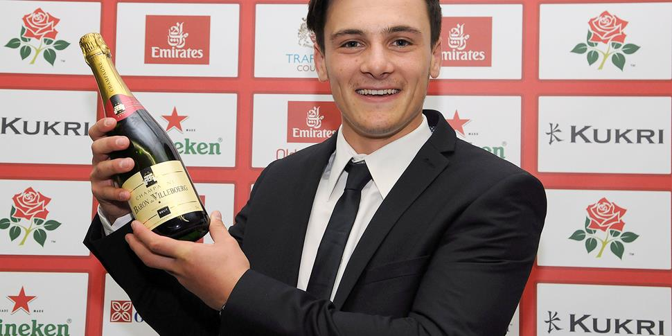 Lancashire County Cricket Club player Rob Jones with the Champagne moment of the year.jpg