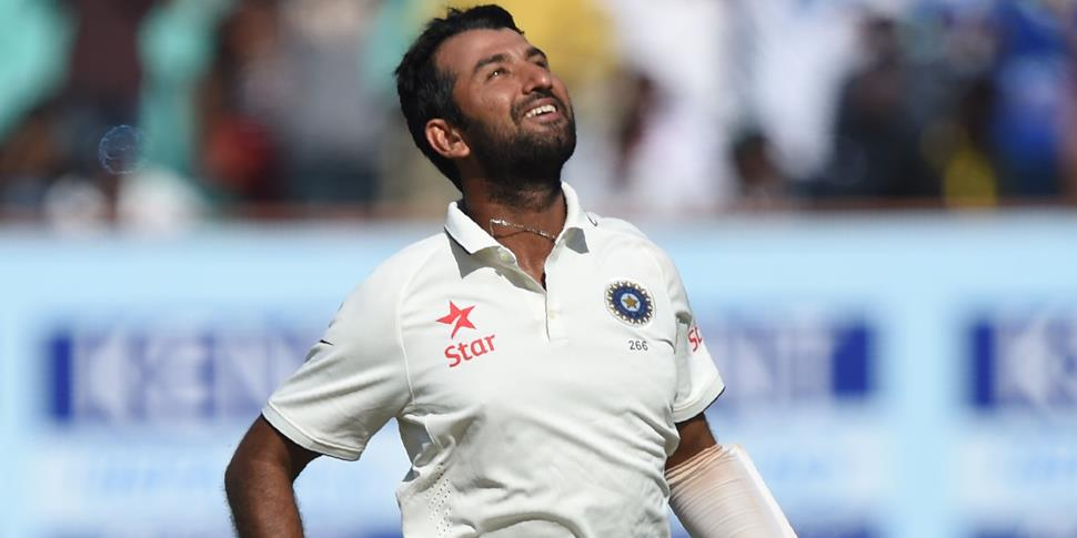 Cheteshwar Pujara celebrates after reach his century in the first test against England.jpg