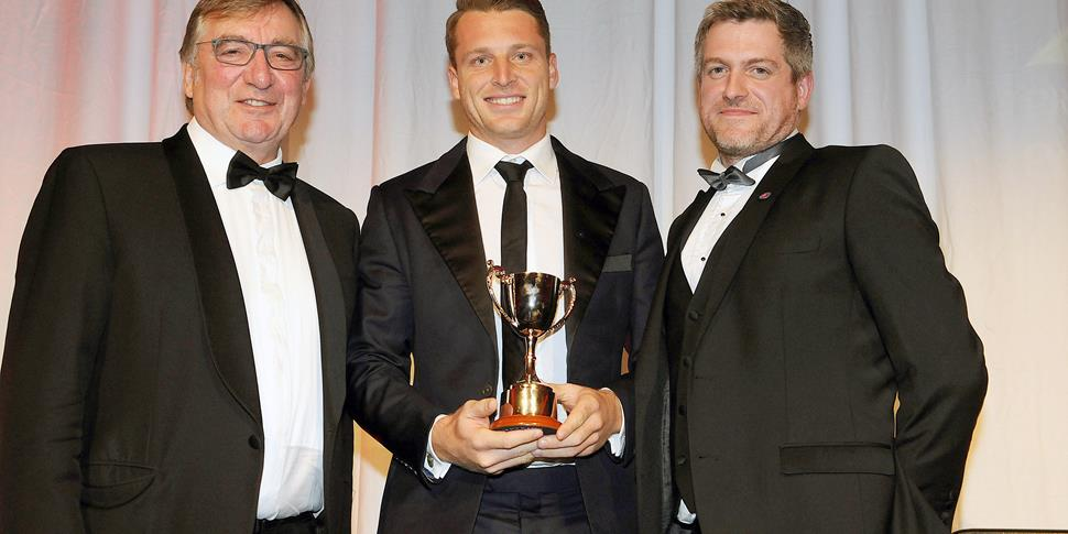 Jos Buttler with the T20 Player of the Year Award.jpg