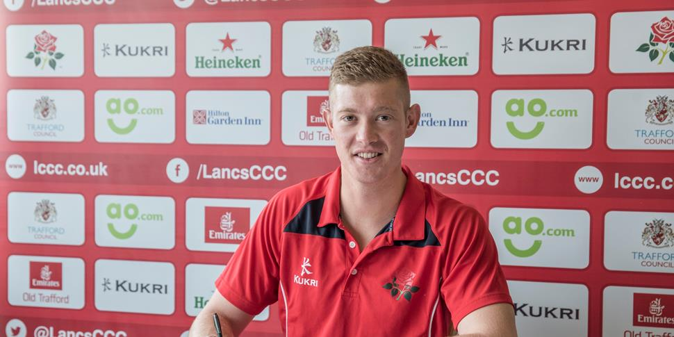 Keaton Jennings signs his contract at Emirates Old Trafford.jpg