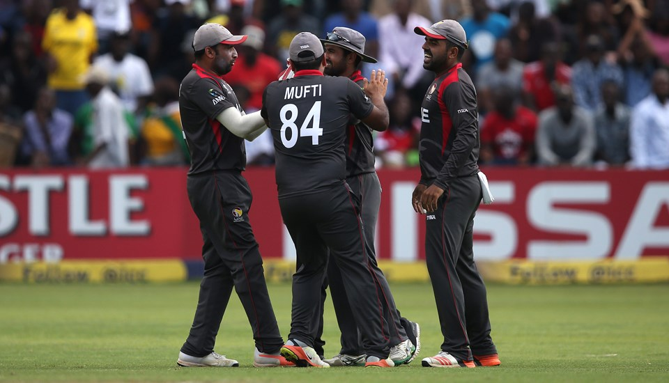 UAE players celebrate the wicket of Solomon Mire of Zimbabwe during The ICC Cricket World Cup Qualifier between the UAE and Zimbabwe.jpg