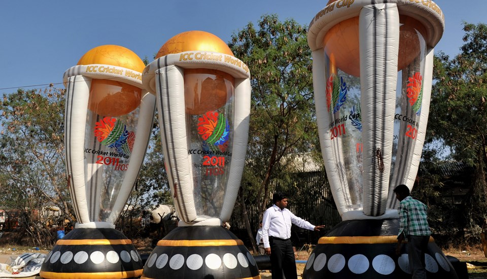 Fans set up inflatable Cricket World Cup trophies.jpg
