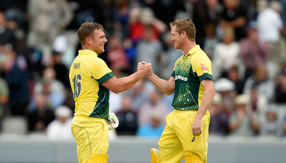 Aaron Finch and George Bailey celebrate a victory against England in the One-Day International at Emirates Old Trafford.jpg