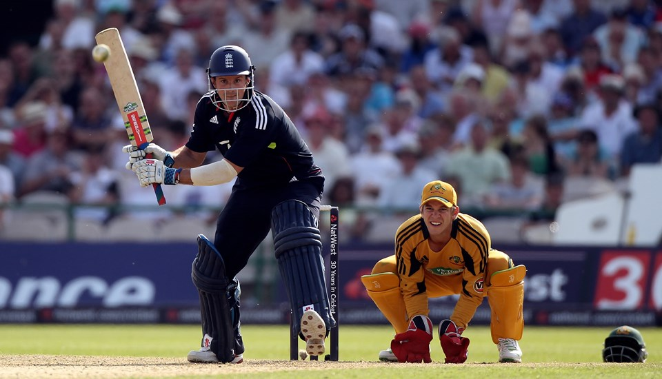 Tim Paine looks on as Andrew Strauss of England hits out during the 3rd NatWest One Day International between England and Australia at Old Trafford.jpg