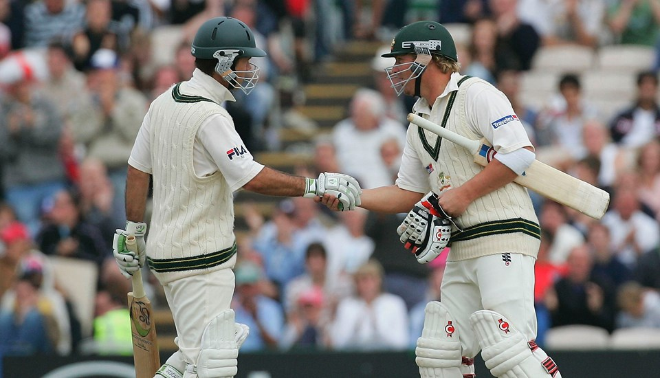 Ricky Ponting is congratulated by Shane Warne after scoring a century against England in the Ashes Test match at Lancashire Cricket Club.jpg