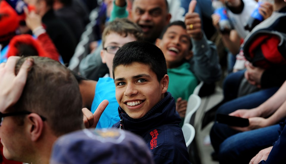 Junior fan smiles to the camera for the T20 Roses Match.jpg