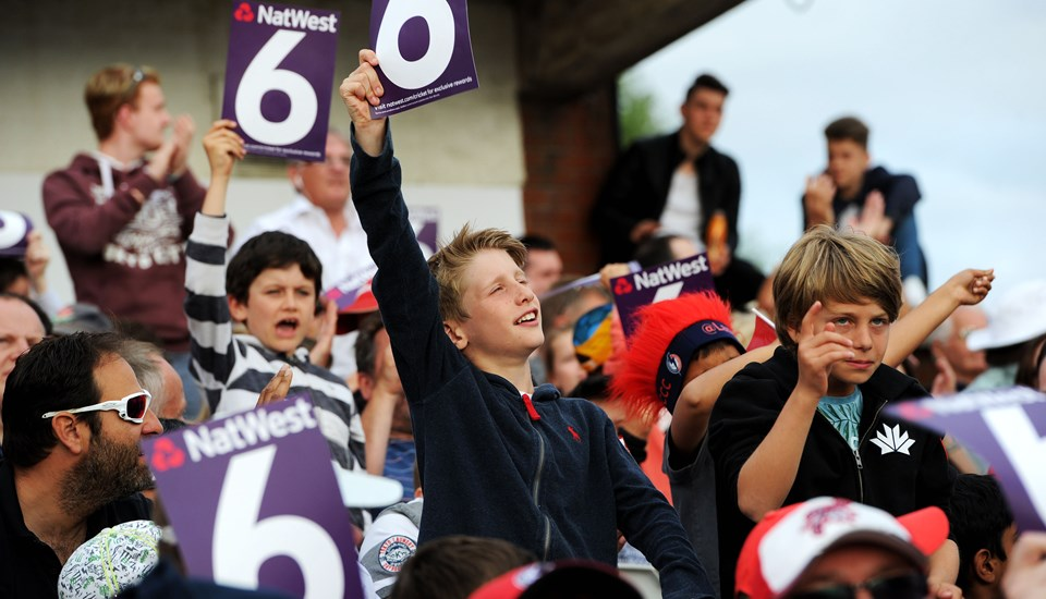 Junior fans singing at the T20 Roses Match.jpg