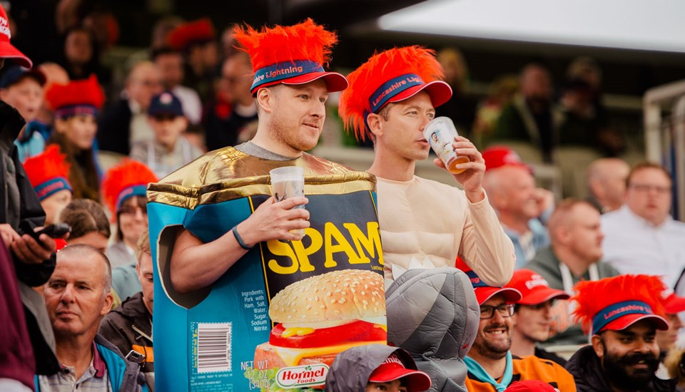 Two fans watch the action between Lancashire and Yorkshire in T20.jpg